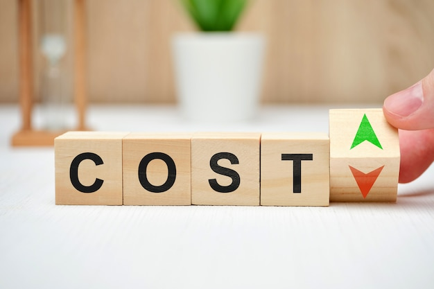 The word cost with up and down arrows as a symbol of change.