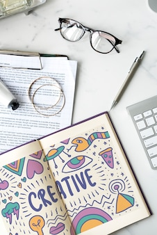 The word creative drawn in a notebook