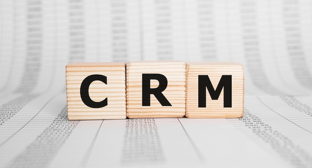 Word crm made with wood building blocks, business concept.