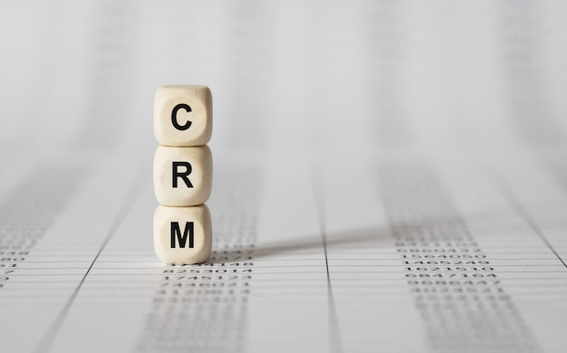 Word crm made with wood building blocks