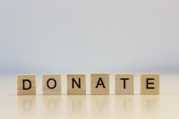 The word donate on cubes