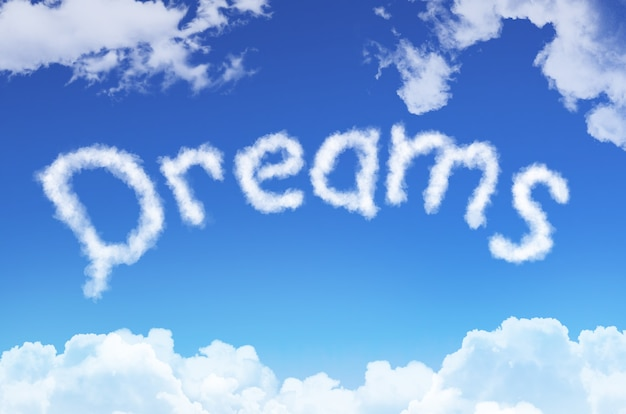 Word dreams from the clouds against the blue sky.