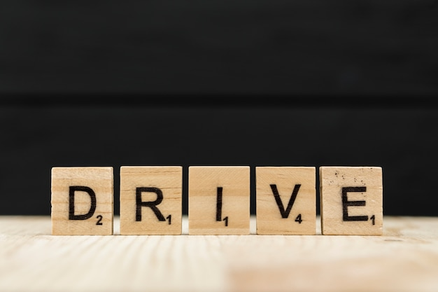 The word drive spelt with wooden letters