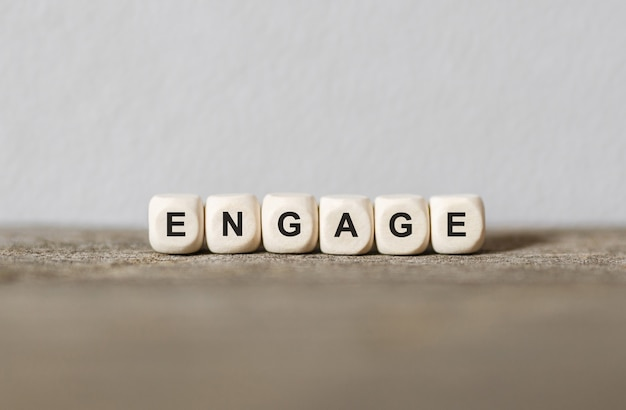 Word engage made with wood building blocks