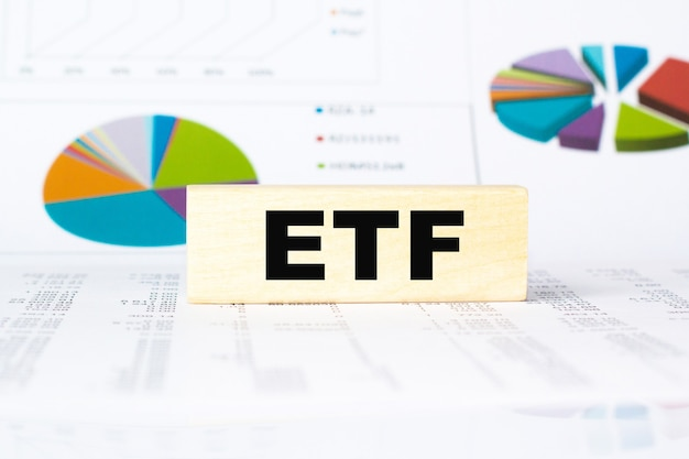 Word etf. wooden small cubes with letters