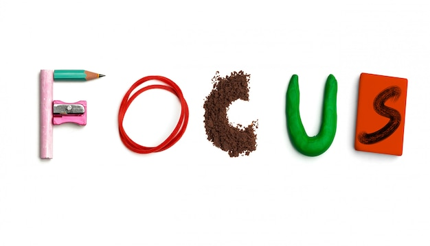 The word focus created from office stationery.