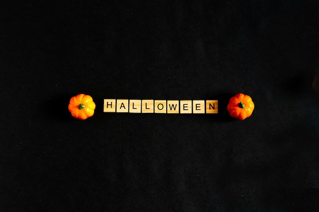 Word halloween made from wooden blocks with lettering