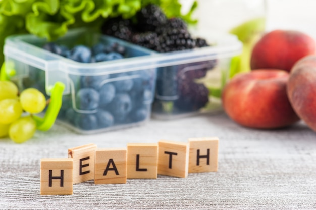 Word health and berries in lunch box