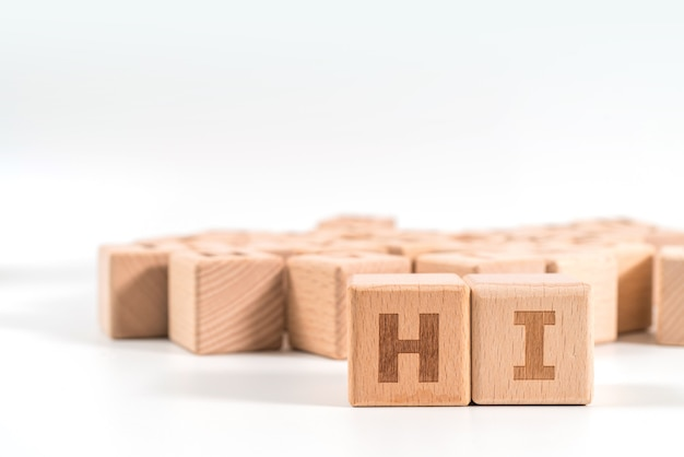 Word hi on wood cube dices