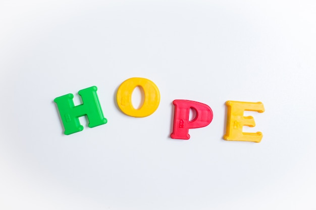 The word hope with multicolor kids letters
