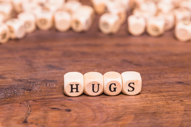 Word hugs written on wooden blocks