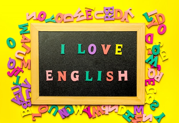 Word i love english made with wooden letters over the wooden board