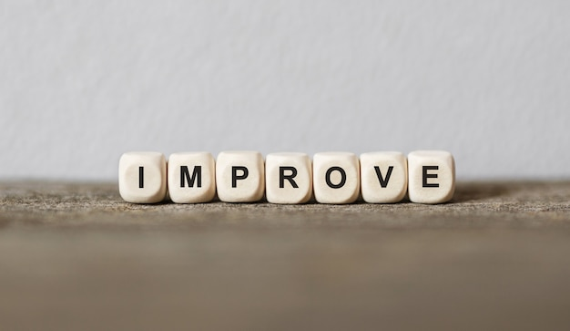 Word improve made with wood building blocks,stock image
