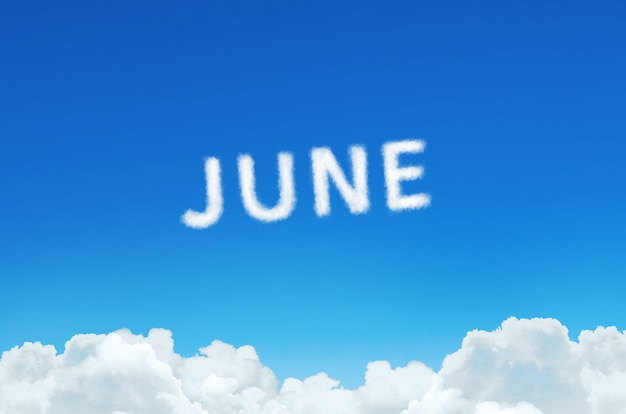 Word june made of clouds steam on blue sky background. month planning, timetable concept.