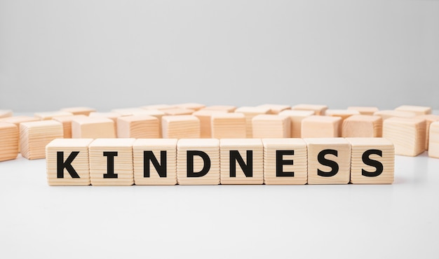 Word kindness made with wood building blocks