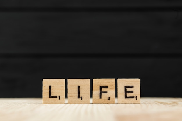 The word life spelt with wooden letters