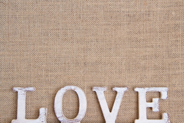 Word love on burlap top view with copy space