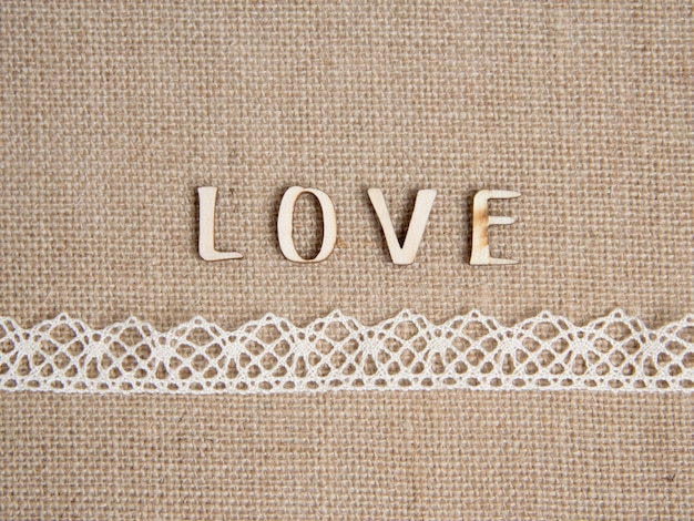 Word love on burlap with lace border