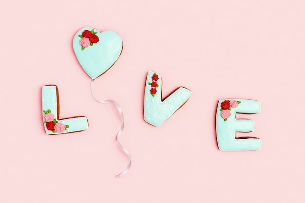 Word love from homemade ginger biscuits  valentines day holiday sweet food