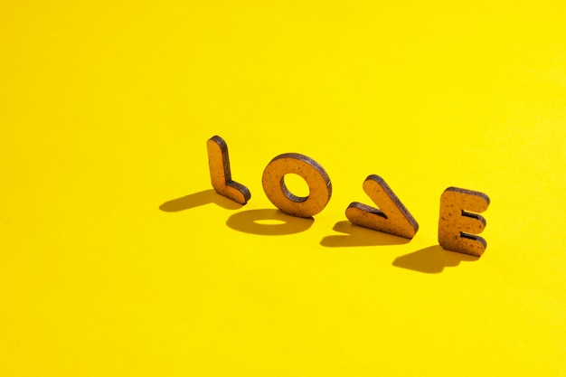The word love from letters on a yellow surface