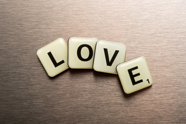 Word love on letter blocks arranged in a curve