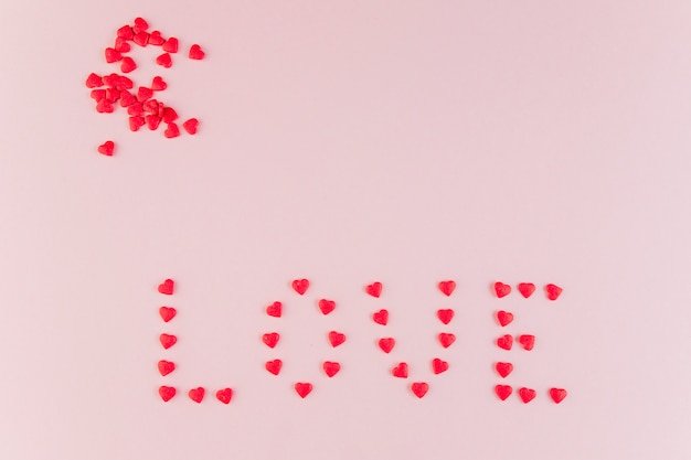 Word love made of decorative hearts
