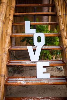 Word love on sandy beach at beautiful resort