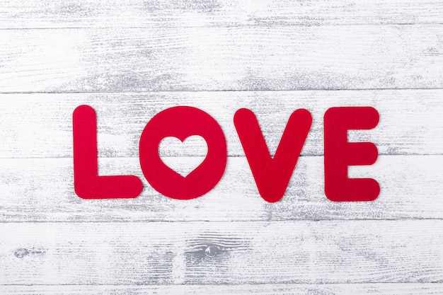 Word love on white wooden table