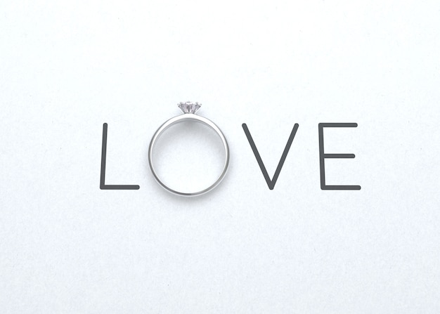 The word love with wedding ring on white paper for valentines day background 3d rendering