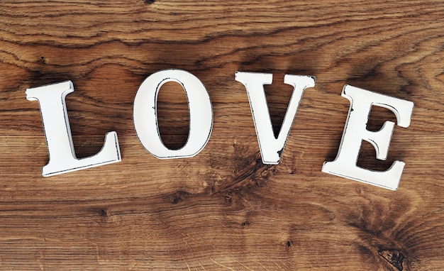 Word love on wooden table
