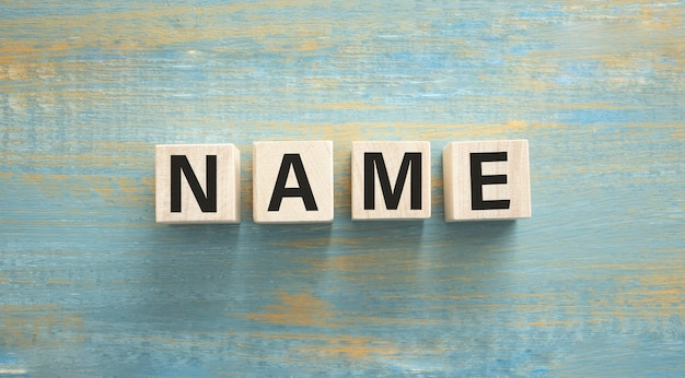 Word name written on wooden cubes