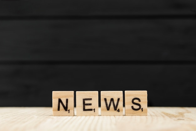 The word news spelt with wooden letters