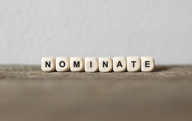 Word nominate made with wood building blocks,stock image