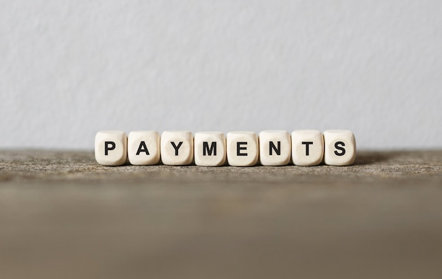 Word payments made with wood building blocks,stock image