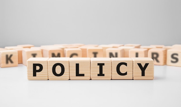 Word policy made with wood building blocks