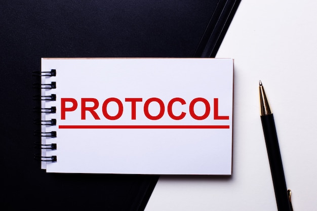 The word protocol written in red on a black and white wall near the pen
