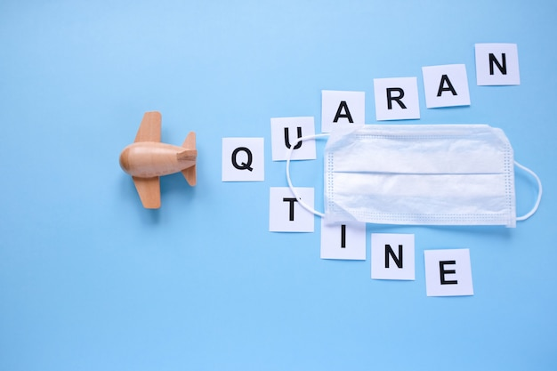 The word quarantine written on a blue background