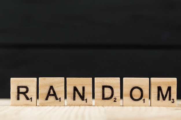 The word random spelt with wooden letters