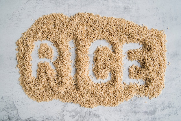 Word rice written on brown rice