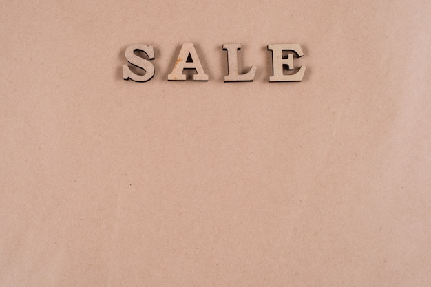 Word sale abstract wooden letters