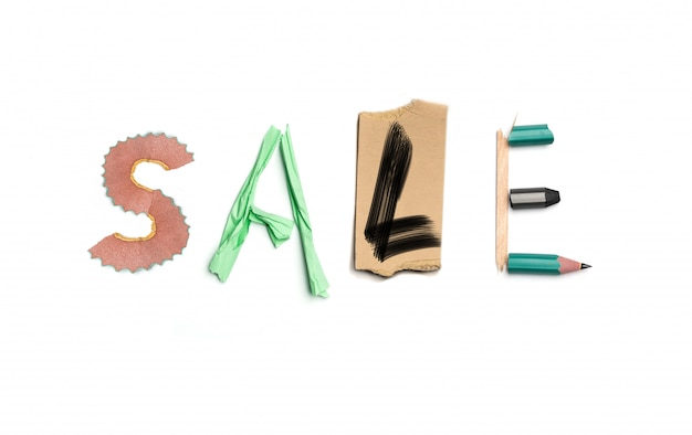 The word sale created from office stationery.