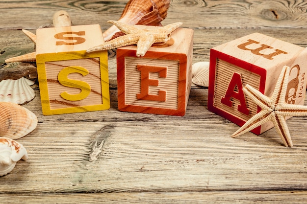 The word sea formed by wooden blocks on wooden table Premium Photo