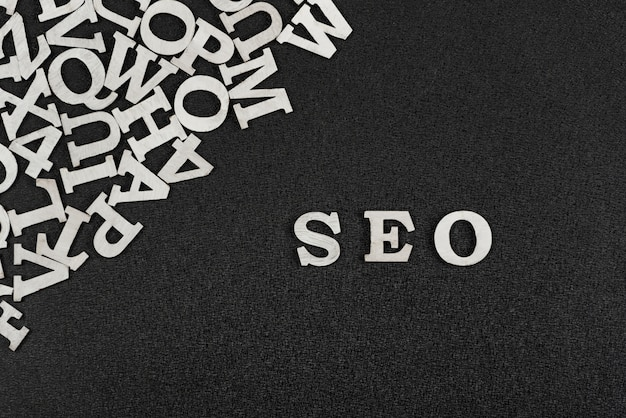 Word seo is composed of white letters on black background. website optimization