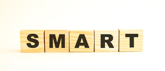 The word smart. wooden cubes with letters isolated on white background. conceptual image.