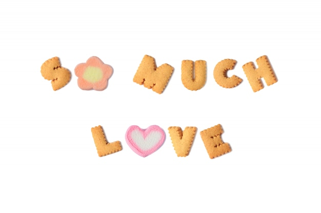 The word so much love spelled with alphabet biscuits and marshmallow