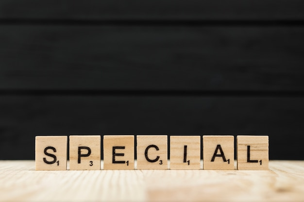The word special spelt with wooden letters
