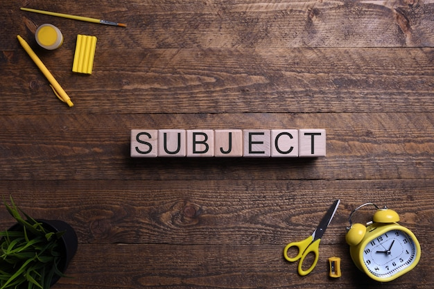 Word subject in wooden cubes