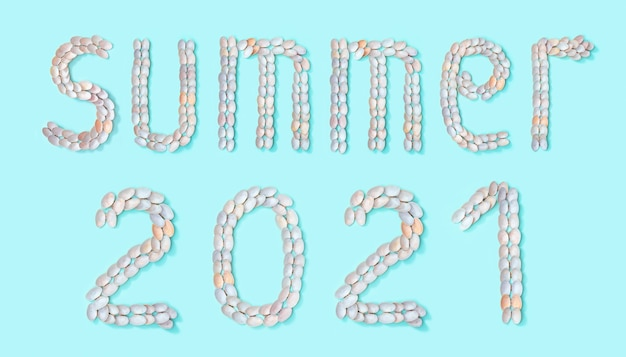 Word summer and number 2021 laid out of small similar natural seashells