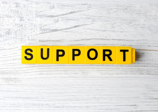 Word support on wooden table