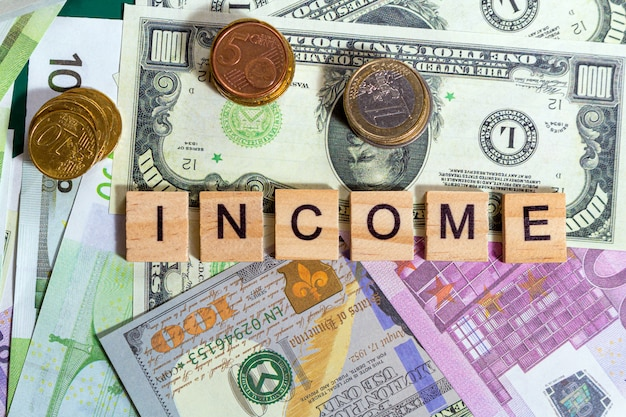 Word text income on the money banknotes